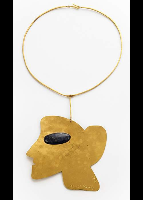 Man Ray 'La Jolie, 1970' pendant in 24 carat gold with lapis. Courtesy of the Louisa Guinness Gallery